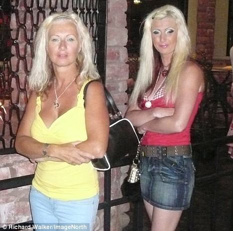 Double take: Janet says she and daughter Jane, right, attract a lot of attention in bars and are regularly mistaken as sisters