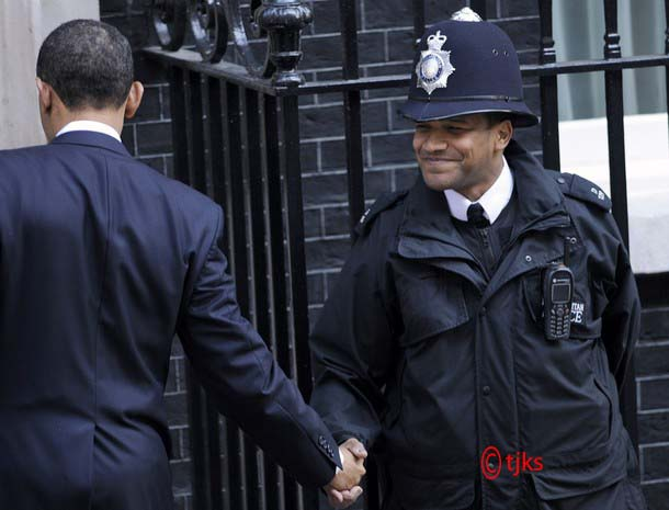 U.S. President Barack Obama (L) shakes hands with a British police officer outside 10 Downing Street  in London April 1, 2009